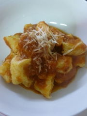 Home made gnocchi with tomato sauce and Parmesan cheese